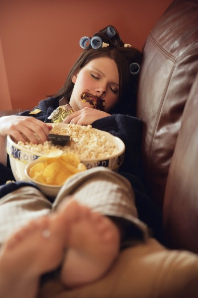 Young Woman Binging On Junk Food